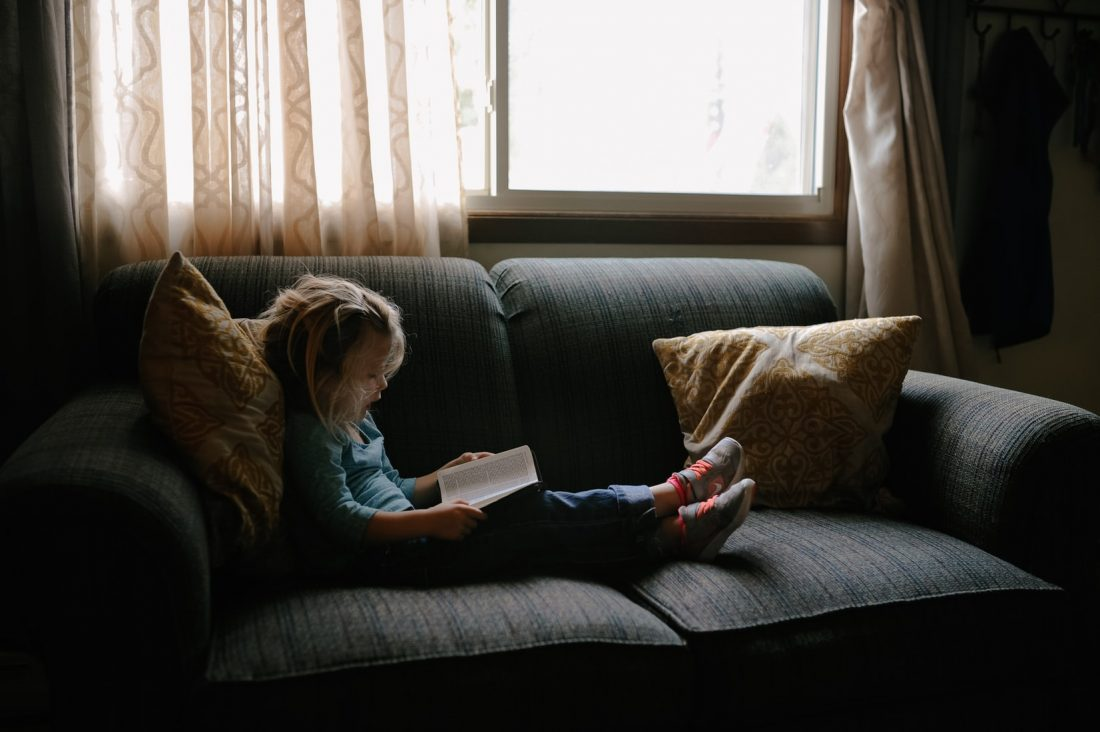 child reads a book